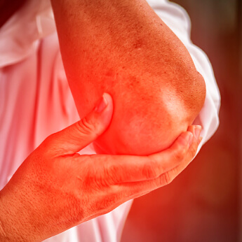 man with pain in the elbow
